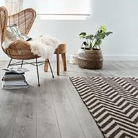 What are the benefits of having an area rug?