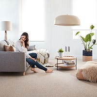 What makes wool carpets ideal for all climates?