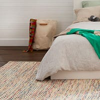 What colours and styles are ideal for a bedroom rug?